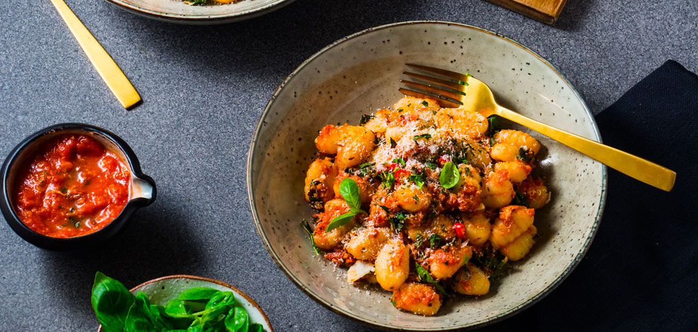 Cheesy Roasted Kale Gnocchi with Spicy Tomato Sauce